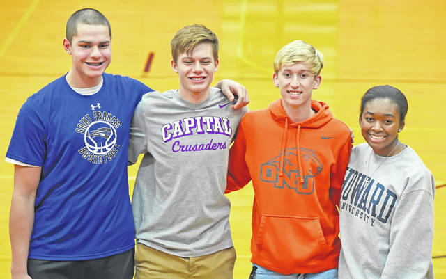 Shawnee High School athletes, from left: Tyson Elwer (St. Francis College, basketball), Landon Hoehn (Capital, soccer), Carter Jensen (Ohio Northern University, soccer), and Shalon McNeal (Howard University, softball) signed their college letters of intent during a signing ceremony at Shawnee High School Wednesday.