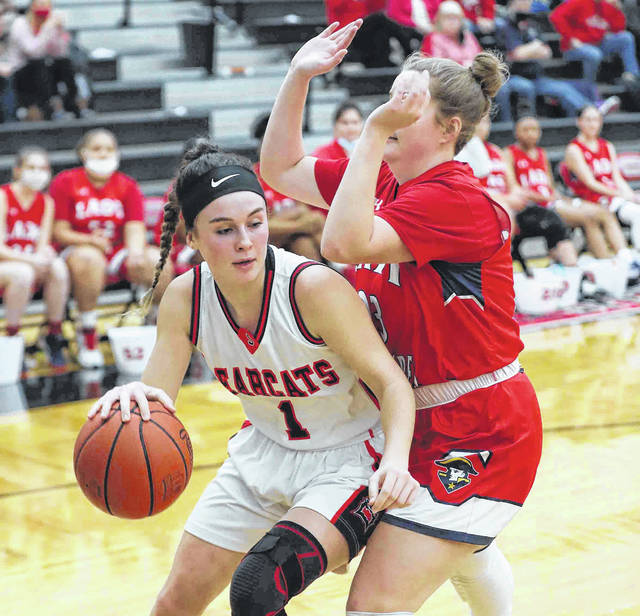 Spencerville's Gillian Goecke drives against Perry's Lexenna Lee during Thursday night's sectional semifinal at Spencerville.