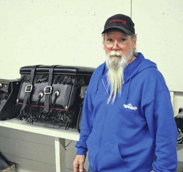"""Jeff Atkinson takes over for Jim and Mary Godwin at the annual motorcycle swap meet at the Allen County Fairgrounds. Atkinson calls it a """"dream come true."""""""
