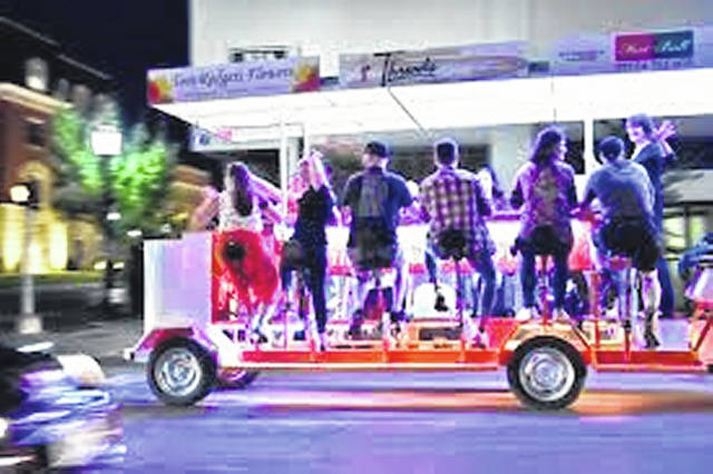A pedal bar can be seen moving around Tiffin at night.