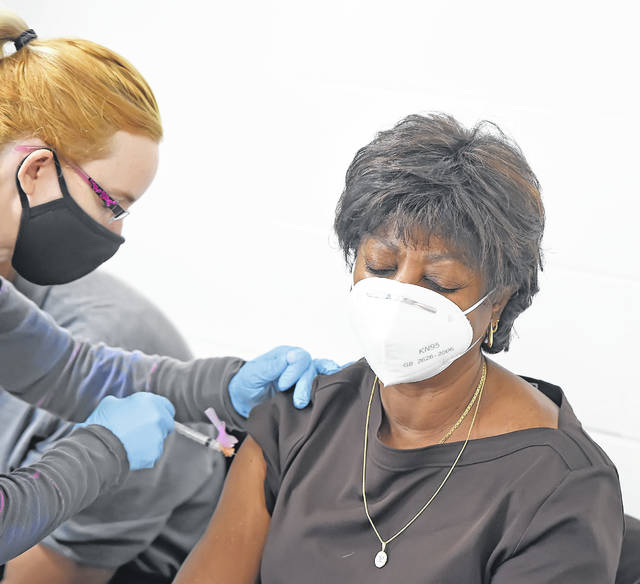 Julia Nunez receives her injection with a dose of the Covid-19 vaccine at the Bradfield Community Center Thursday morning.