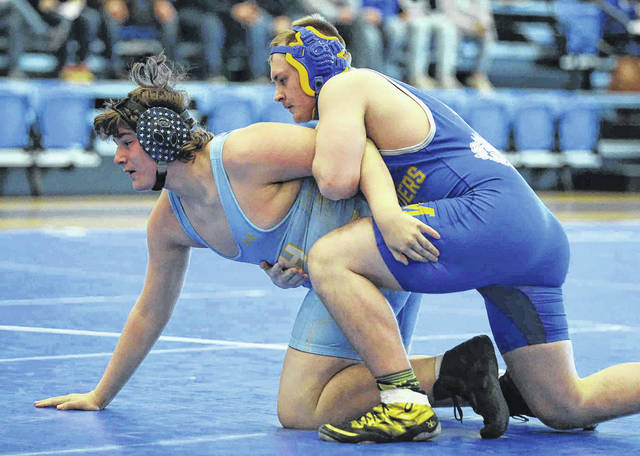 St. Marys' Carter Sharpe, right, competes against Bath's Zoran Cannode during Saturday's WBL Championships at Defiance. See more event photos at LimaScores.com.