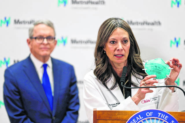 Former Ohio Department of Health Director Dr. Amy Acton, shown here in February 2020 with Ohio Gov. Mike DeWine, acknowledged she stepped down from her job at a nonprofit to consider running for a U.S. Senate seat.