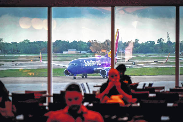 A Southwest Airlines plane taxis to the gate at Hobby Airport in Houston on Friday.