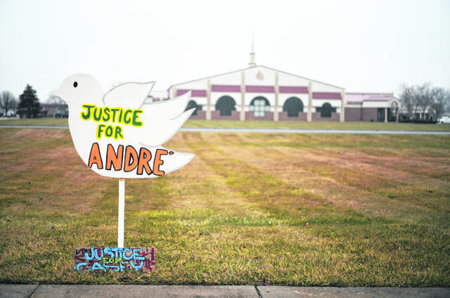"FILE — Signs reading ""Justice for Andre'"" and ""Justice for Casey,"" in reference to Andre' Hill and Casey Goodson Jr., both Black men killed at the hands of law enforcement in Columbus, sit outside the First Church of God before the funeral of Andre Hill on Tuesday, Jan. 5, 2021 in Columbus, Ohio. Hill, a 47-year-old Black man, was shot and killed by Columbus Division of Police Officer Adam Coy in the early morning of Dec. 22, 2020 after officers responded to a non-emergency call in the area."