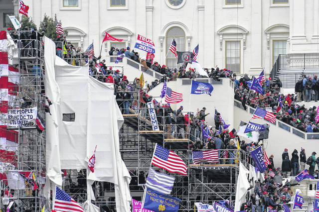 Rioters loyal to President Donald Trump are shown storming the U.S. Capitol in Washington on Jan. 6. Arguments begin Tuesday in the impeachment trial of Donald Trump on allegations that he incited the mob.