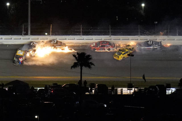 A crash on the final lap took out Joey Logano (22) who was leading before the wreck, Brad Keselowski (2) who was in second and several other cars, opening the door for Michael McDowell to win the Daytona 500. (AP Photo/Chris O'Meara)
