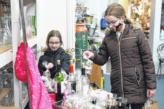 Twelve year-old Katherine and eight year-old Lydia Gretz of Bluffton pick out a cupcake at Town and Country Flowers.