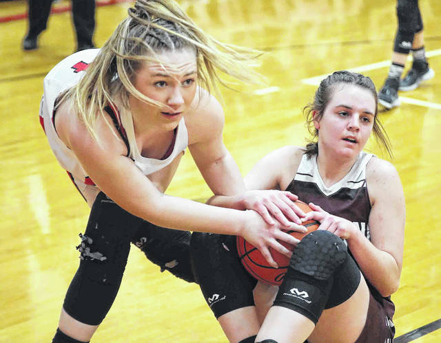 Delphos Jefferson's Mallory Bridges, left, and Paulding's Jalynn Parrett go for a loose ball during Saturday night's sectional final at Delphos. See more game photos at LimaScores.com.