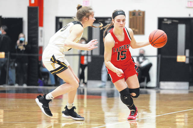 Delphos Jefferson's Alyvia Lindeman keeps the ball away from Fairview's Karrie Smith during a Thursday night Division III district semifinal at Elida.