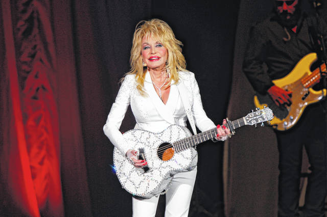 """Dolly Parton, shown during a concert on July 31, 2015, is asking Tennessee lawmakers to withdraw a bill that would erect a statue of her on the Capitol grounds in Nashville. In a statement released Thursday, Parton says that given current events, she doesn't think being put on a pedestal """"is appropriate at this time."""""""