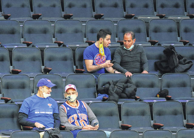 Fans wait for an NBA basketball game between the New York Knicks and the Golden State Warriors at Madison Square Garden on Tuesday.