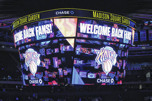 The scoreboard displays a message welcoming fans to an NBA basketball game between the Golden State Warriors and the New York Knicks on Tuesday.