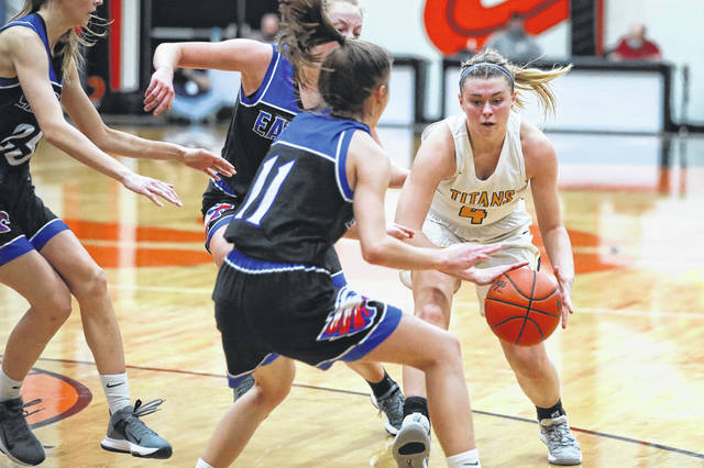 Liberty-Benton players descend upon Ottawa-Glandorf's Kelsey Erford during a Thursday night Division III district semifinal at Elida. See more district semifinals photos at LimaScores.com.