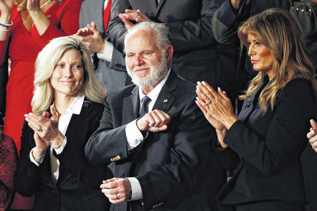 In this Feb. 4, 2020.file photo, Rush Limbaugh reacts as first Lady Melania Trump, and his wife Kathryn, applaud, as President Donald Trump delivers his State of the Union address to a joint session of Congress on Capitol Hill in Washington.