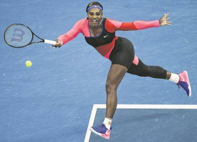 Serena Williams hits a return to Simona Halep during their Australian Open quarterfinal match Tuesday in Melbourne, Australia.