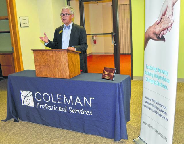John Bush | The Lima News Nelson Burns, president/CEO of Coleman Professional Services, speaks Thursday at a ribbon-cutting ceremony for the organization's newest office in downtown Wapakoneta.