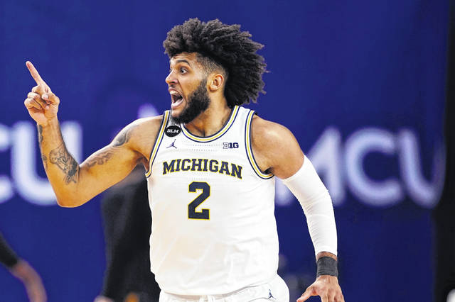 Michigan forward Isaiah Livers reacts after hitting a three-point basket during the first half of an NCAA college basketball game against Iowa, Thursday, Feb. 25, 2021, in Ann Arbor, Mich. (AP Photo/Carlos Osorio)