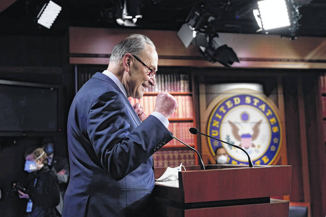 Senate Majority Leader Chuck Schumer of New York speaks during a news conference after the Senate passed a COVID-19 relief bill in Washington on Saturday.