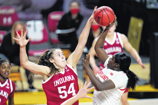 FILE - Indiana forward Mackenzie Holmes (54) blocks a shot by Maryland guard Ashley Owusu during the second half of an NCAA college basketball game in College Park, Md., in this Jan. 4, 2021, file photo. This week, No. 9 Indiana begins a new quest — dethroning No. 7 Maryland as tourney champs in Indianapolis.