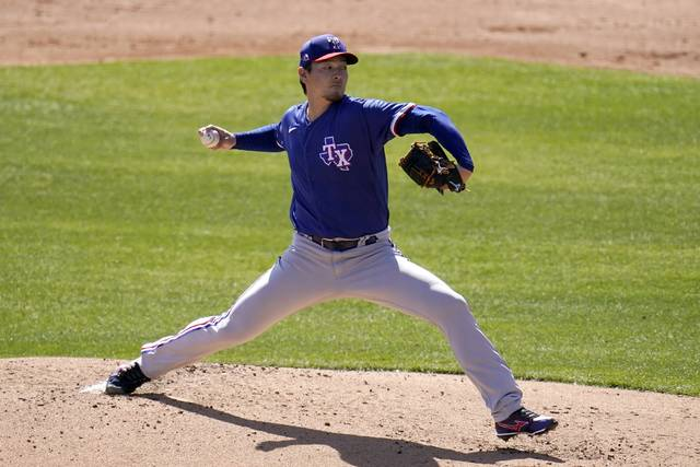 Texas Rangers starting pitcher Kohei Arihara, of Japan, throws a pitch against the Chicago White Sox during the first inning of a spring training baseball game Tuesday in Phoenix.
