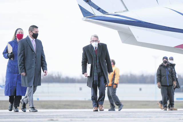 In this Nov. 18, 2020, file photo, Ohio Gov. Mike DeWine, middle, walks away from a plane before the start of a press conference at Toledo Express Airport in Swanton. Republican lawmakers' latest in a year-long attempt to rein in DeWine's authority to issue public health orders during the pandemic passed in the House on Wednesday and faces a likely veto by the governor.
