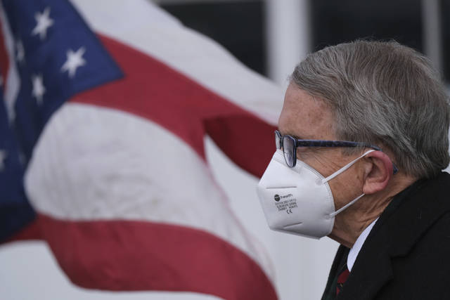 ADVANCE FOR RELEASE MARCH 14, 2021, AND THEREAFTER - FILE - This Wednesday, Nov. 18, 2020 file photo shows Ohio Gov. Mike DeWine looking on during a news conference at Toledo Express Airport in Swanton, Ohio. A year after the first coronavirus shutdowns, many U.S. states and cities are still struggling with a silent side effect: Public records have become harder to get. After months of repeated AP inquiries, DeWine's office on March 3, 2021, released just two documents from last spring — one from a hospital association proposing criteria for resuming elective procedures. (J.D. Pooley/Sentinel-Tribune via AP, File)
