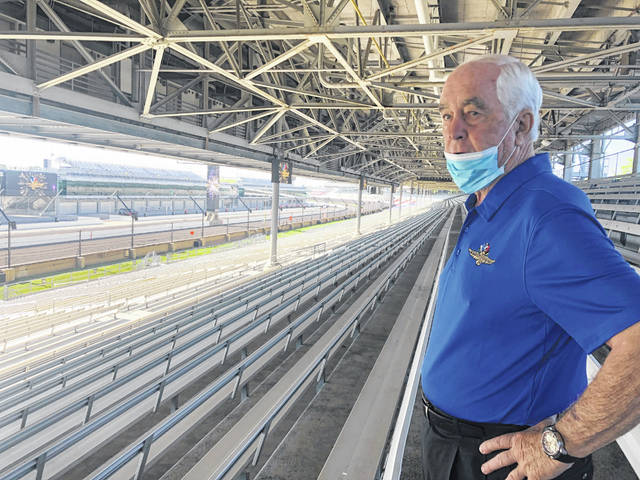 Roger Penske looks over the track from the grandstand at Indianapolis Motor Speedway in Indianapolis, in this July 2, 2020, file photo. There will be fans at this year's Indianapolis 500, Penske said Monday but how many remains a moving target based on pandemic restrictions. Penske said more than 170,000 tickets have already been sold for the May 30 race. His first Indy 500 as owner of the historic property ran in front of empty grandstands last year.