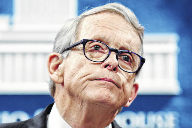 Ohio Gov. Mike DeWine pauses while speaking at the Ohio Statehouse in August in Columbus. On Tuesday, DeWine vetoed a bill that would've limited the governor's authority during health emergencies.