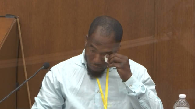 In this image from video, witness Donald Williams wipes his eyes as he answers questions, as Hennepin County Judge PeterCahill presides Tuesday, March 30, 2021, in the trial of former Minneapolis police officer Derek Chauvin at the Hennepin County Courthouse in Minneapolis, Minn.   Chauvin is charged in the May 25, 2020 death of George Floyd.  (Court TV via AP, Pool)
