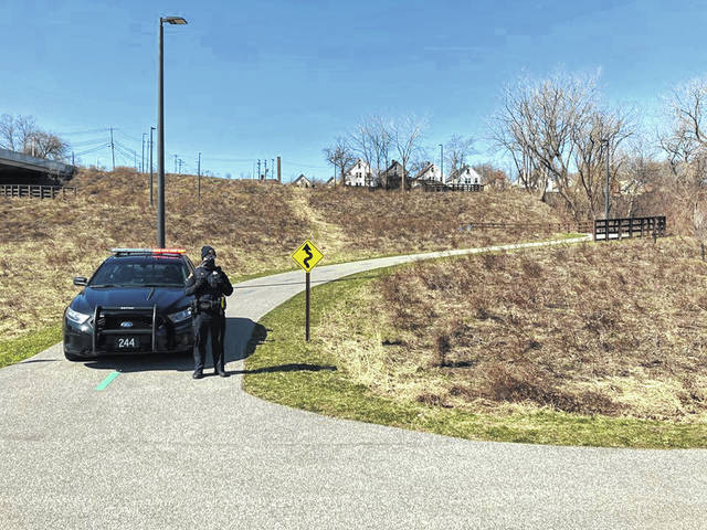 A walker discovered a 20-year-old man's body on a towpath trail in Clark fields Saturday morning. Eric Heisig, Tribune News Service