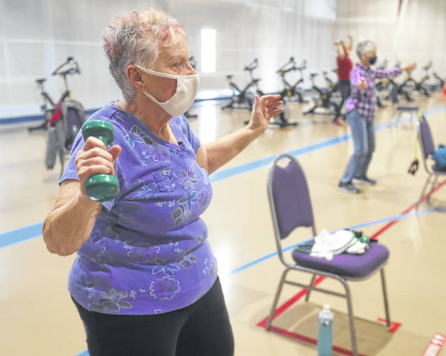 Evelyn Balough of Goodyear Heights works out in the Senior Fitness with Margo class at the Tallmadge Rec Center on Wednesday, March 17, 2021 in Tallmadge, Ohio.  [Phil Masturzo/ Beacon Journal]