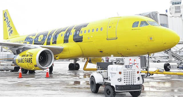 A Spirit Airlines flight that departed from Cleveland en route to Los Angeles landed in Denver Thursday after a passenger tried to open an exit door while in flight.