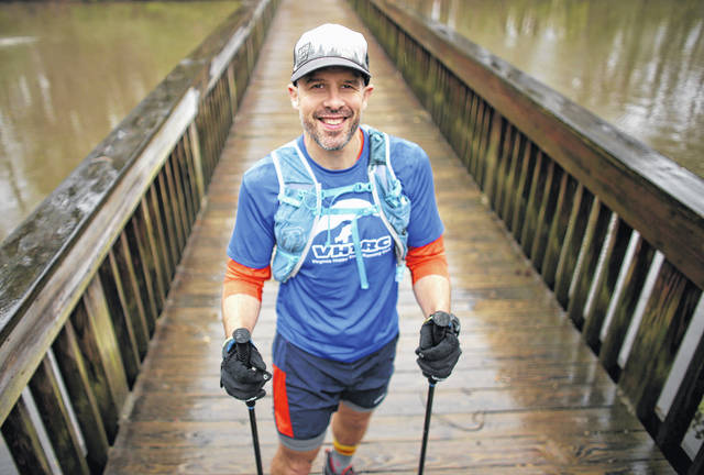 John Waite of Newport News, shown March 19 on the Noland Trail, embarked March 27 on a 544-mile trek on the Appalachian Trail. Waite will walk 40 miles per day over a two-week period.