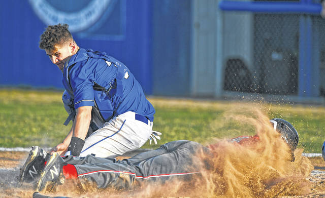 Lima Senior's D'Ontre Cowan slides safely into home before Allen East's Chase Miller can apply the tag during Tuesday's game at Allen East. See more game photos at LimaScores.com.