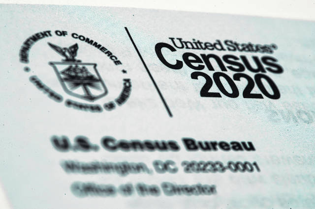 FILE - This March 19, 2020, file photo, shows a 2020 census letter mailed to a U.S. resident.  Alabama on Wednesday became the second state to challenge the U.S. Census Bureau's decision to delay by six months the release of data used for redrawing congressional and legislative districts, as it took aim at the accuracy of a privacy protection system that it alleged is holding up the process. (AP Photo/Matt Rourke, File)
