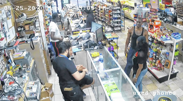In this image from store video, George Floyd, right, is seen inside Cup Foods on May 25, 2020, in Minneapolis. Former Minneapolis Police officer Derek Chauvin is on trial for the death of Floyd at the Hennepin County Courthouse in Minneapolis, Minn. (Court TV via AP, Pool)In this image from store video, George Floyd, right, is seen inside Cup Foods on May 25, 2020, in Minneapolis. Former Minneapolis Police officer Derek Chauvin is on trial for the death of Floyd at the Hennepin County Courthouse in Minneapolis, Minn.