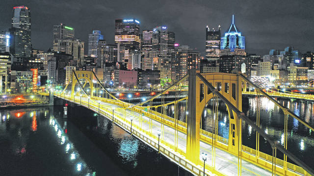 The newly refurbished Rachel Carson Bridge over the Allegheny River in downtown Pittsburgh is shown Nov. 26, 2020. President Joe Biden wants $2 trillion to re-engineer America's infrastructure and expects the nation's corporations to pay for it. The Democratic president traveled to Pittsburgh on March 31 to unveil what would be a hard-hatted transformation of the U.S. economy. (AP Photo/Gene J. Puskar/File)The newly refurbished Rachel Carson Bridge over the Allegheny River in downtown Pittsburgh is shown Nov. 26, 2020. President Joe Biden wants $2 trillion to re-engineer America's infrastructure and expects the nation's corporations to pay for it. The Democratic president traveled to Pittsburgh on March 31 to unveil what would be a hard-hatted transformation of the U.S. economy.