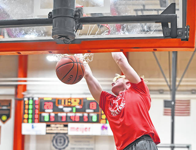 St. Marys' Jadin Davis scores on a dunk for the West during the District 8 Division I-II-III All-Star Game on Tuesday night at the Elida Fieldhouse. See more All-Star photos at LimaScores.com.