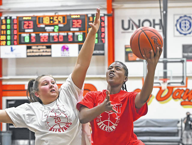 Lima Senior's Cheyanne Bean shoots against Kenton's Lindsey Smith during Monday's District 8 All Star game at the Elida Fieldhouse.