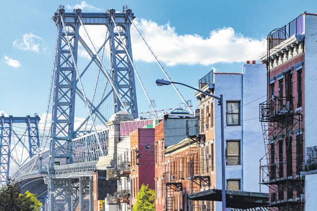 A street in Brooklyn, N.Y., shows the Williamsburg Bridge in the background. More than one-third of those who left Manhattan during the pandemic moved to Brooklyn.