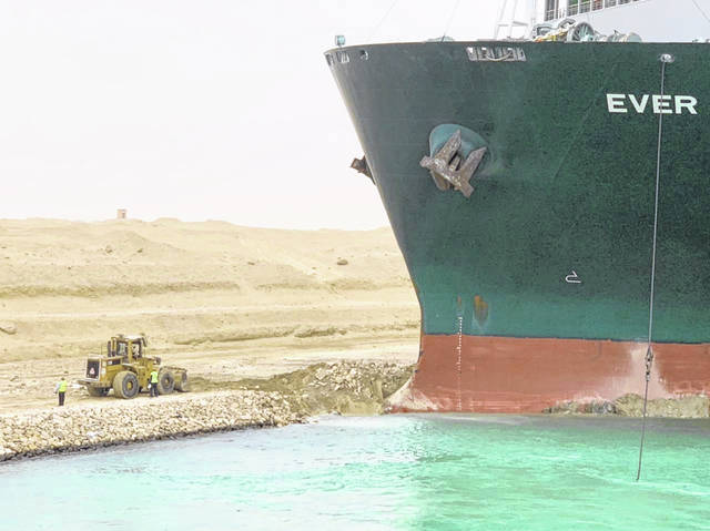 The Evergreen cargo container ship Ever Given, trapped on the Suez Canal of Egypt, added further strain to supply chains hampered by the coronavirus pandemic. (Suez Canal Head Office/Xinhua/Zuma Press/TNS)