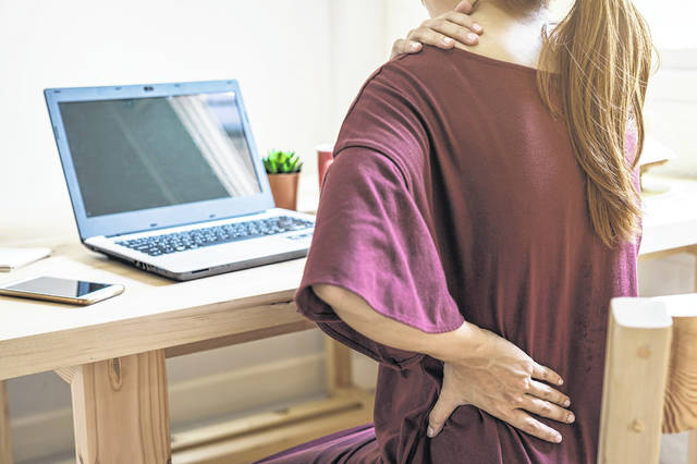 Less-than-ideal workstations, combined with sedentary work habits, have taken a physical toll on those working from home as the pandemic has dragged on. (Dreamstime.com/TNS)