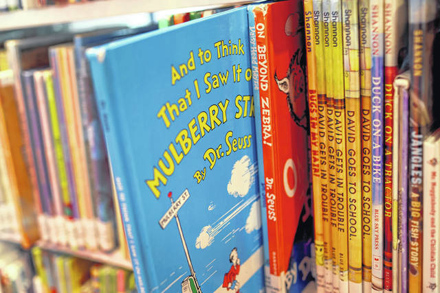 """Books by Theodor Seuss Geisel, aka Dr. Seuss, including """"On Beyond Zebra!"""" and """"And to Think That I Saw It on Mulberry Street,"""" are offered for a loan at the Chinatown Branch of the Chicago Public Library on March 2 in Chicago."""