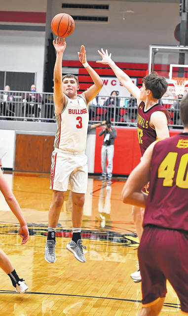 Columbus Grove's Tayt Birnesser connects on a 3-point basket with 12 seconds remaining to give the Bulldogs the lead for good during Friday night's Division IV regional championship game against New Bremen at Van Wert. See more regional photos at LimaScores.com.