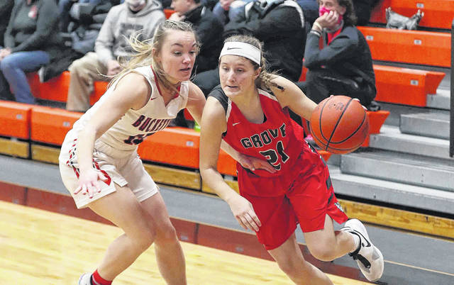 Columbus Grove's Kenzie King drives against Buckeye Central's Taylor Ratliff during a Division IV regional semifinal Thursday night at Elida. See more regional photos at LimaScores.com.