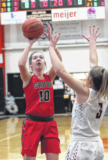 Columbus Grove's Erin Downing puts up a shot against Buckeye Central's Kendra Ackerman during a Division IV regional semifinal Thursday night at Elida.