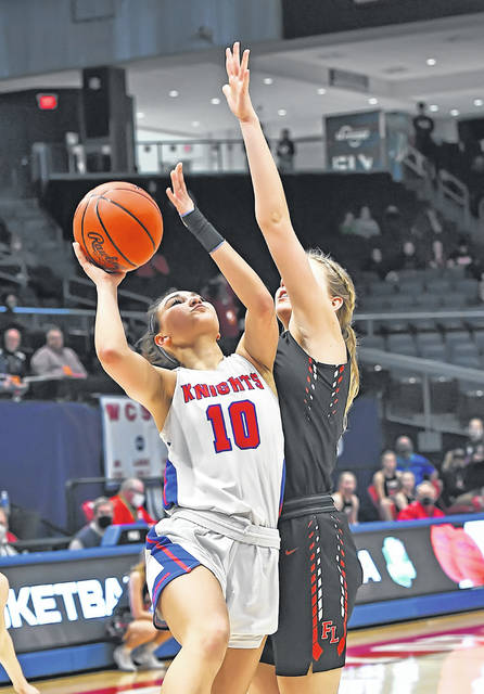 Crestview's Laci McCoy puts up a shot against Fort Loramie's Dana Rose during a Thursday Division IV state semifinal at University of Dayton Arena. See more photos from Thursday's state semifinals at LimaScores.com.