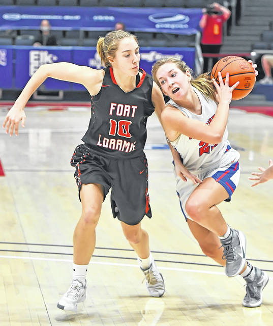 Crestview's Olivia Cunningham drives against Fort Loramie's Colleen Brandewie during a Thursday Division IV state semifinal at University of Dayton Arena.