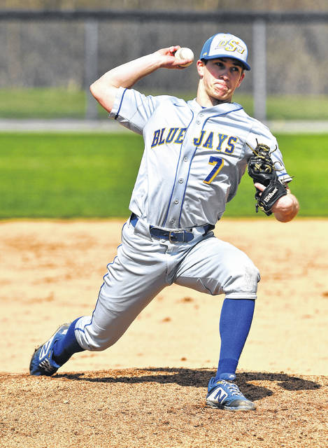 Brady Kerner of Delphos St. John's pitches during Saturday's game against Lima Central Catholic at Stadium Park.